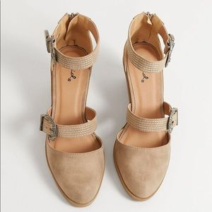 Cupid heel with buckles and back zip.